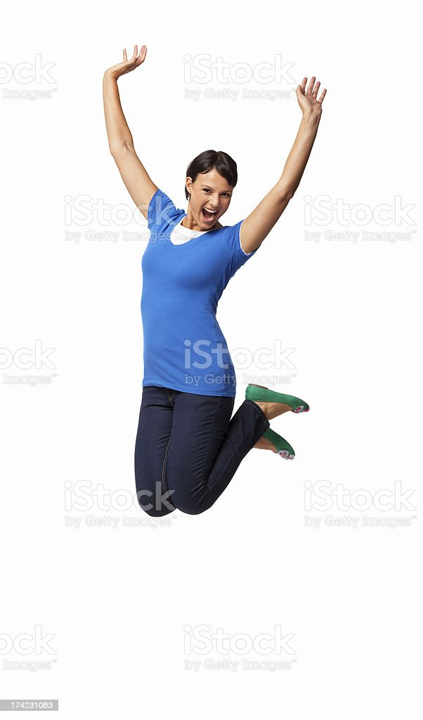 Elated Woman Jumping In Mid-air - Isolated royalty-free stock photo