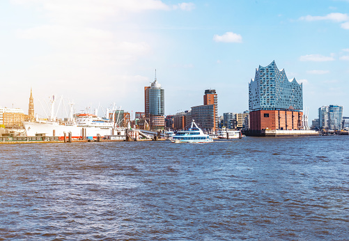 Elbe river and waterfront skyline in Hamburg, Germany on sunny day
