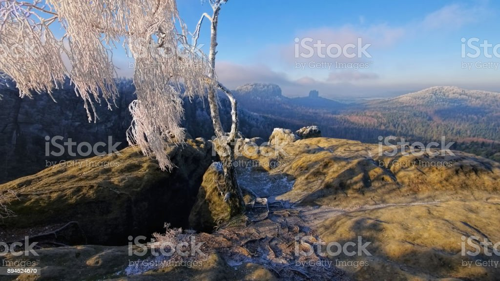 Elbe sandstone mountains in winter and hoarfrost, viewpoint Domerker stock photo