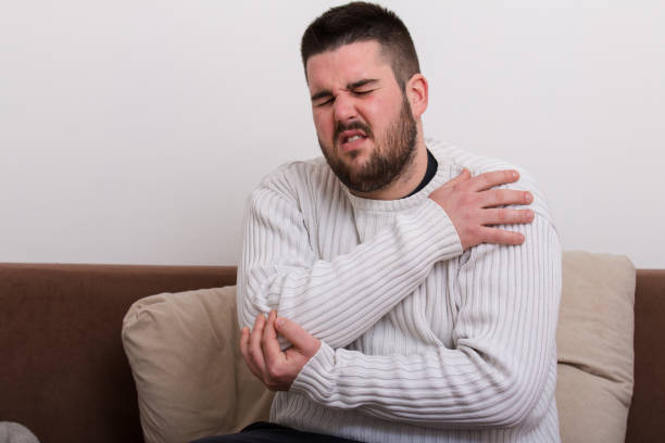 Elbow pain Elbow pain gout stock pictures, royalty-free photos & images