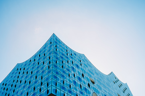 Elbphilharmonie, Wide shot - bright blue sky over top shape of the building, Hamburg, Germany