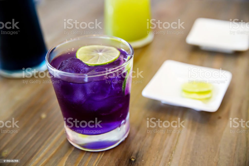 elcome drink, butterfly pea flower juice with lemon slice. stock photo