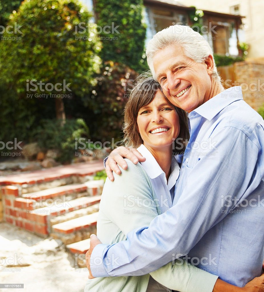 Elder couple hugging each other and smiling royalty-free stock photo