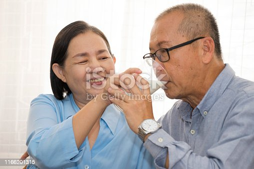 elder couple man and woman take care together in moment of love, care and happiness  hold their hands  and  spend private time