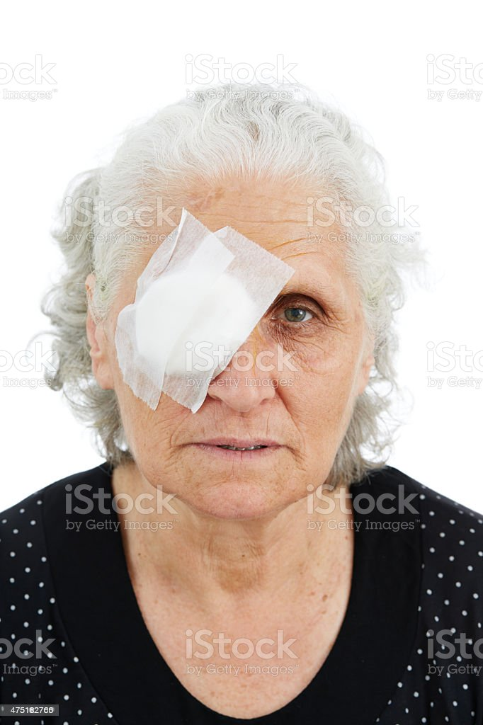 Elder female with eye patch stock photo