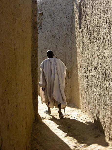 Elder in the alleyways of Saba (Mali, Africa) stock photo
