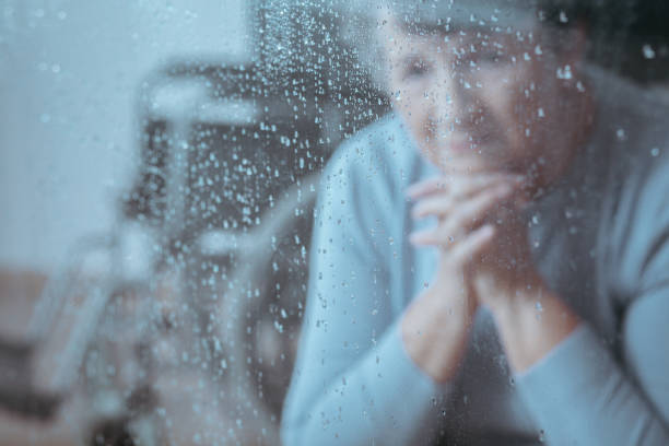 elder lady sitting - grief stock photos and pictures