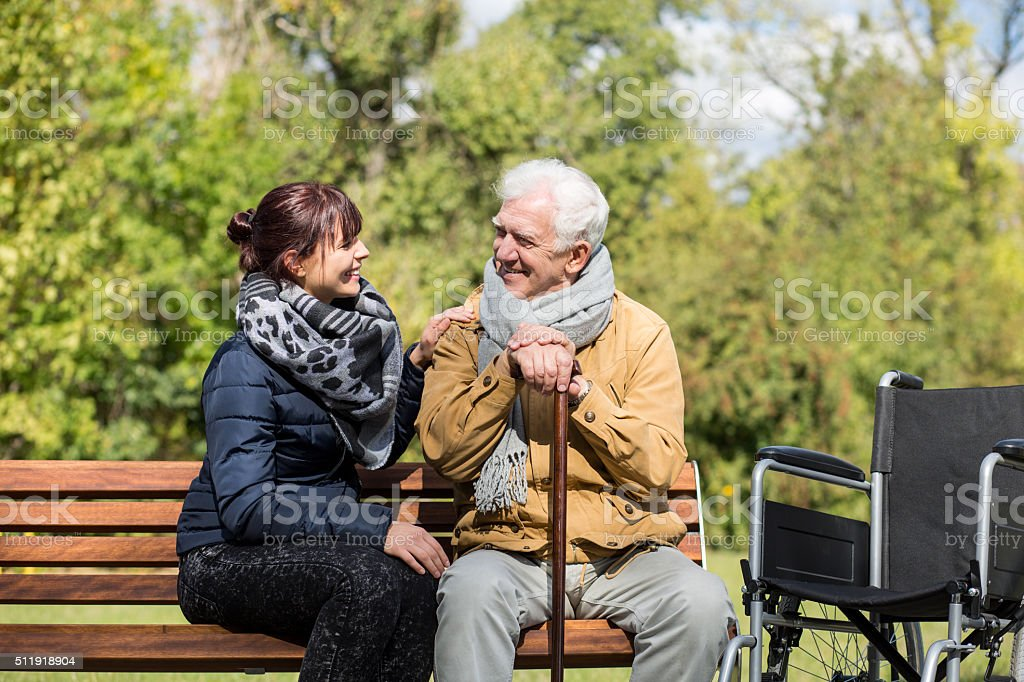 Elder man and carer stock photo