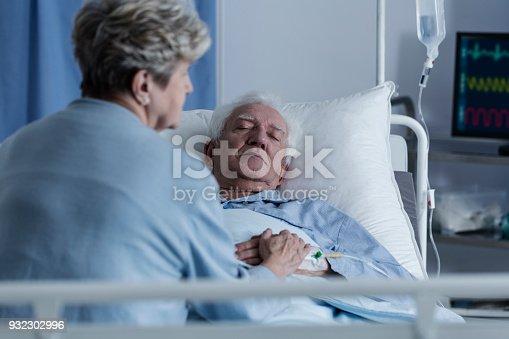902077950istockphoto Elder man in coma 932302996