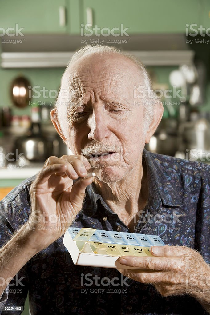 Elder Man with a Pill Case royalty-free stock photo