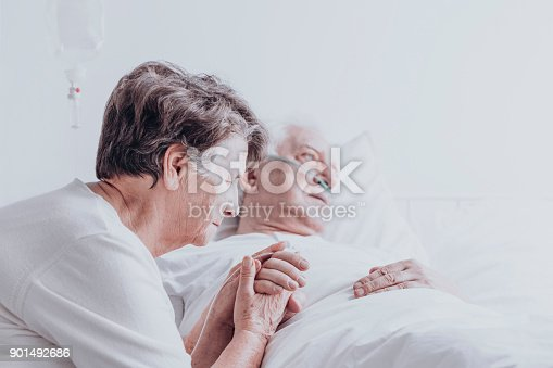 902077950istockphoto Elder married couple in hospital 901492686