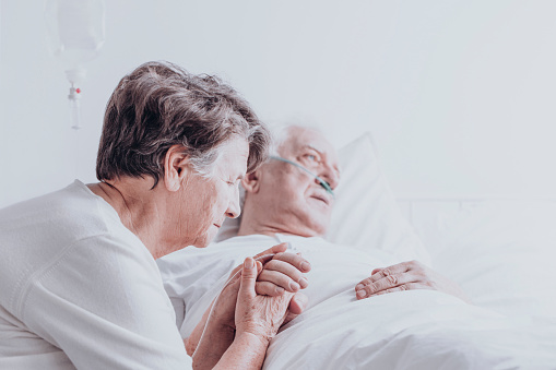 902077950 istock photo Elder married couple in hospital 901492686