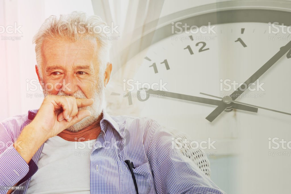 elder thinking with times clock background for life time pass memory...