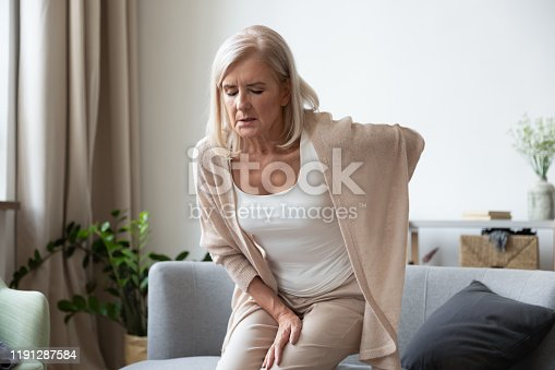 821012164istockphoto Elderly 60s woman suffer from back ache 1191287584
