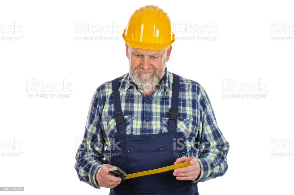 Elderly builder holding utensils stock photo