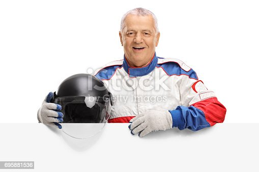 istock Elderly car racer behind a panel 695881536