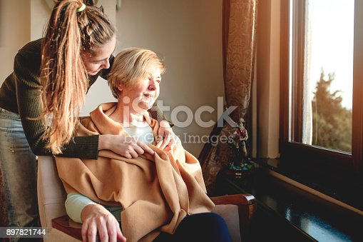 istock Elderly care old and young 897821744