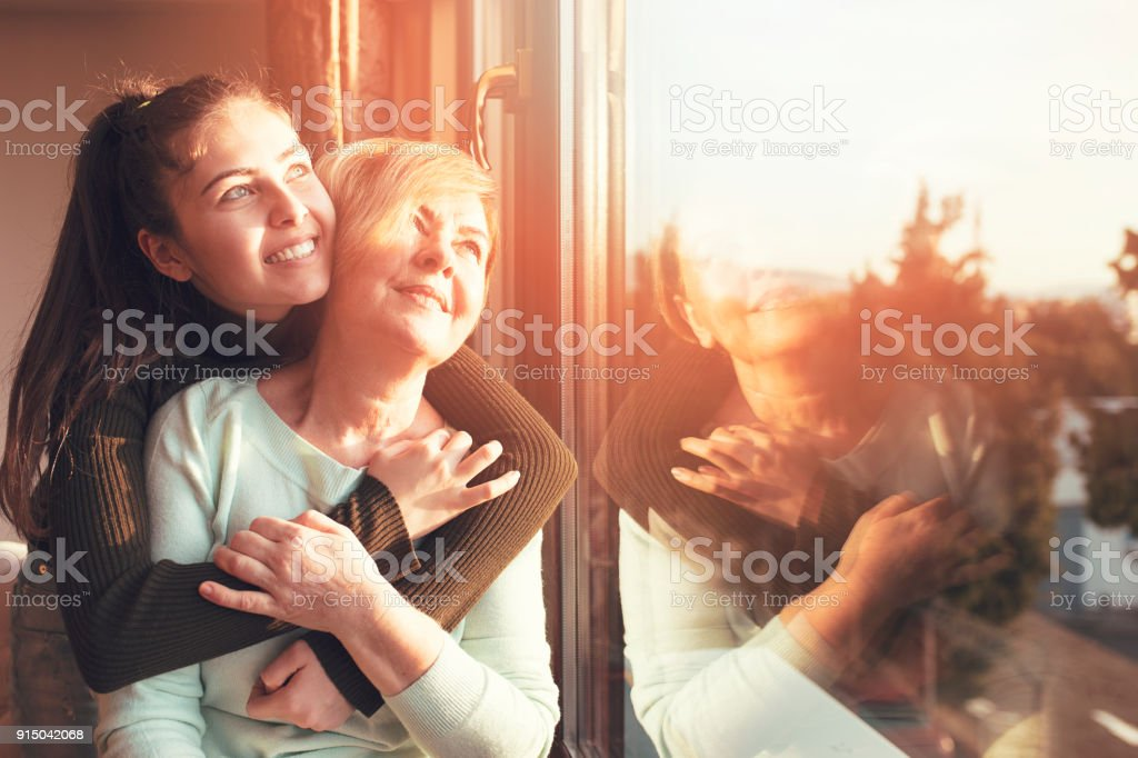 Elderly care old and young stock photo