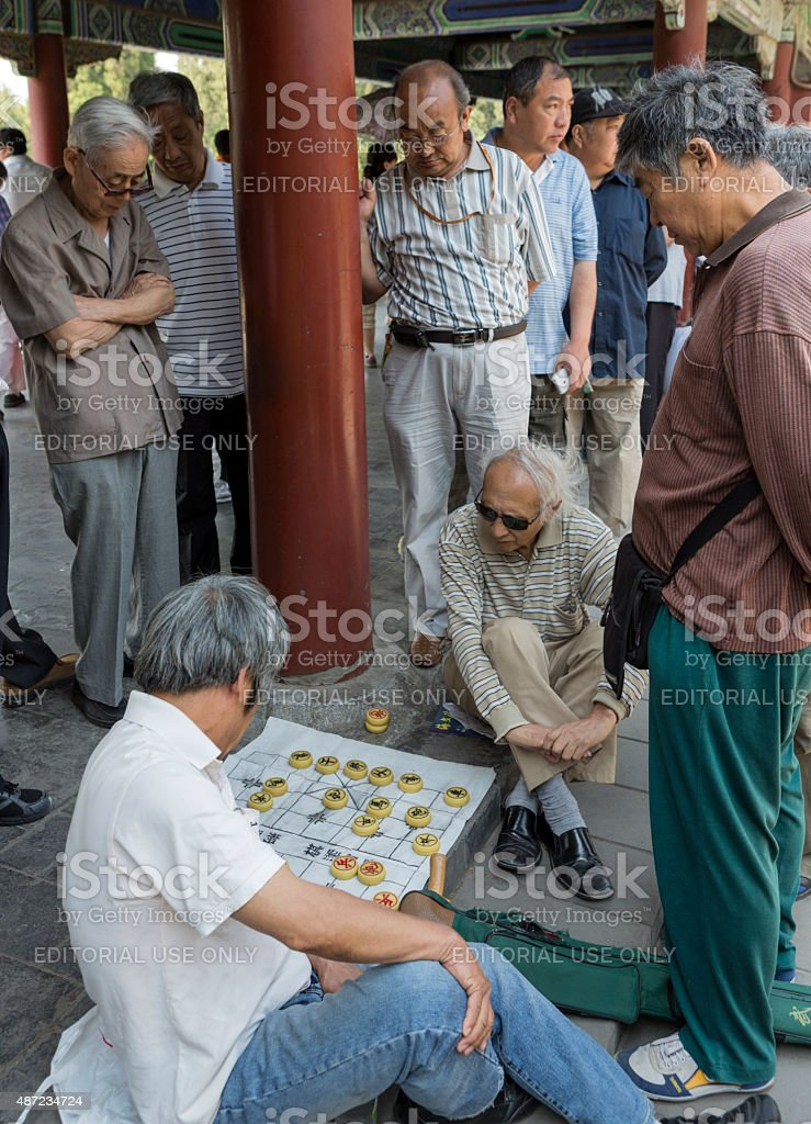 Elderly Chinese men playing Chinese Checkers in a Beijing Park stock photo