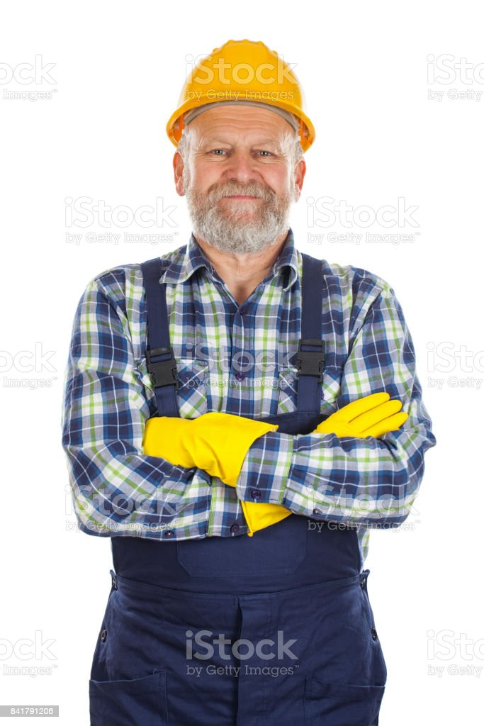 Elderly constructor with arms crossed stock photo