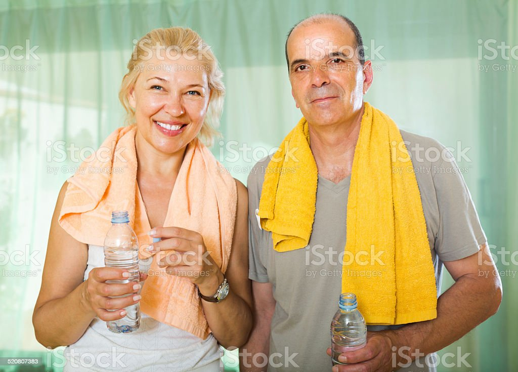 Elderly couple after training stock photo