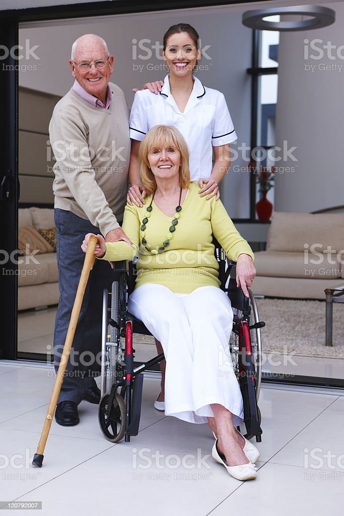 Elderly Couple and a Nurse royalty-free stock photo
