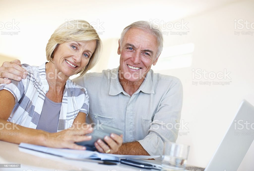 Elderly couple calculating budget royalty-free stock photo