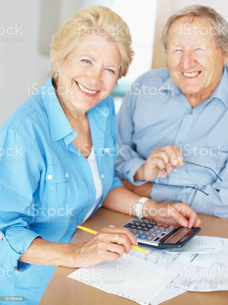 Elderly couple discussing budget at home royalty-free stock photo