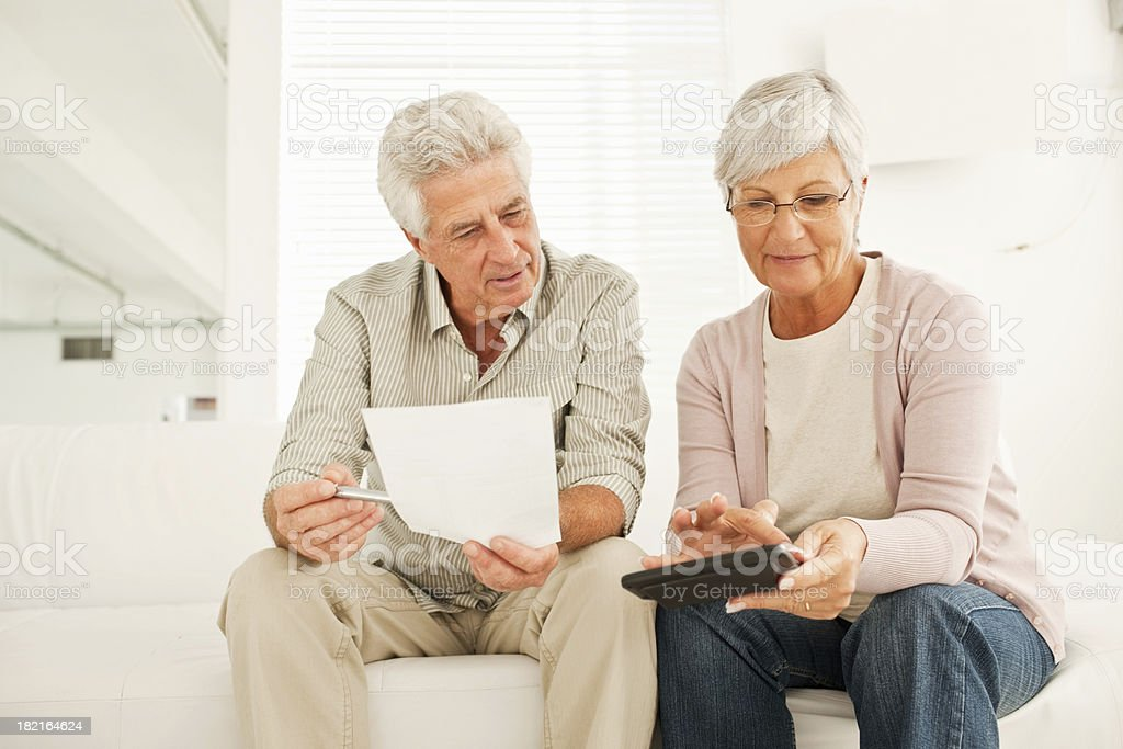 Elderly couple discussing budget royalty-free stock photo