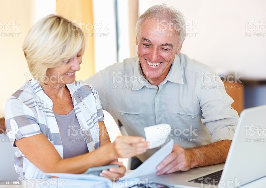 Elderly couple happy about their budgeting royalty-free stock photo