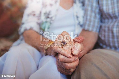 istock Elderly couple holding hands 547513026