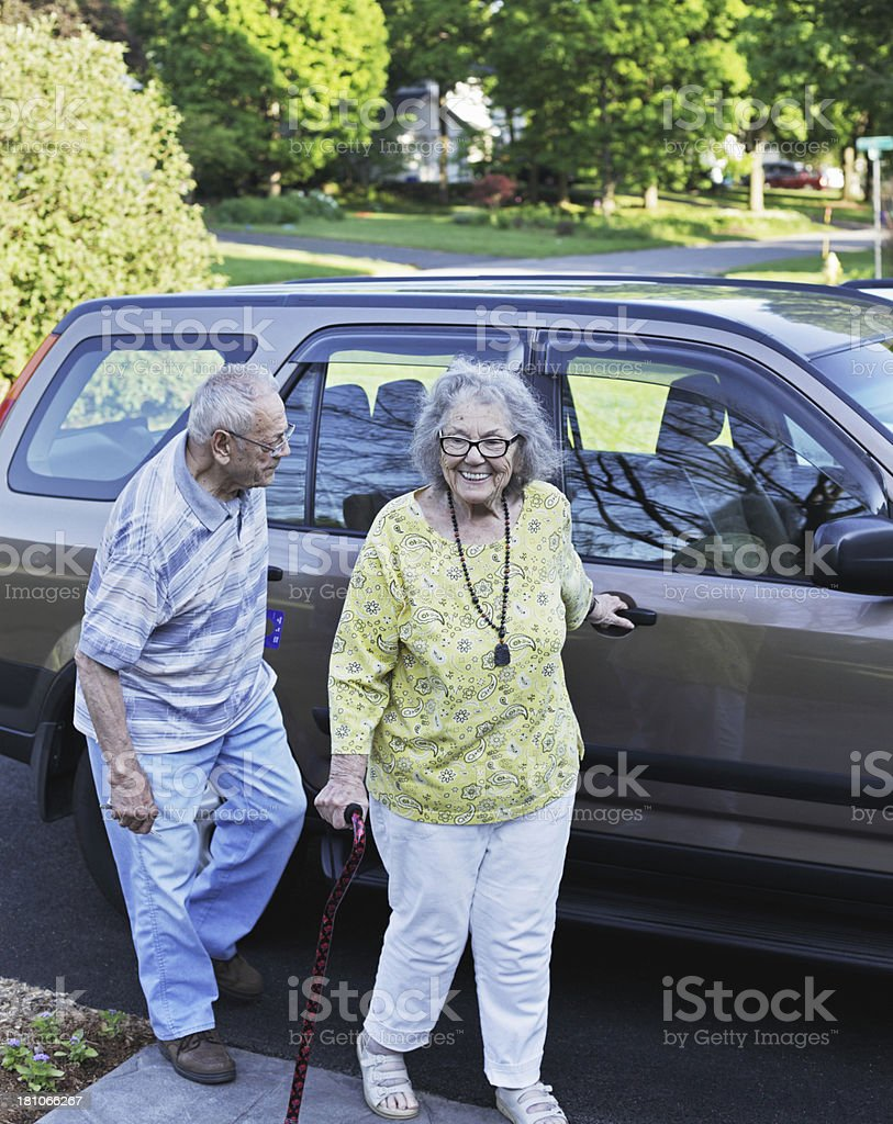 Elderly Couple Home After Car Ride royalty-free stock photo