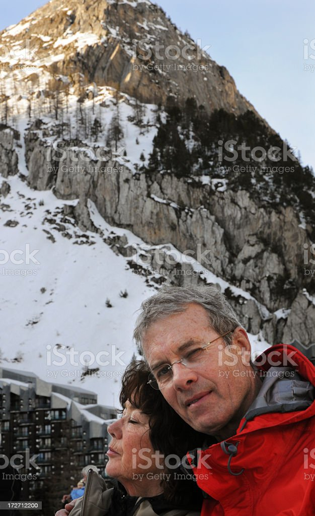 Elderly Couple In Front Of Mountain royalty-free stock photo