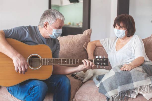 Elderly couple in medical masks during the pandemic coronavirus stock photo
