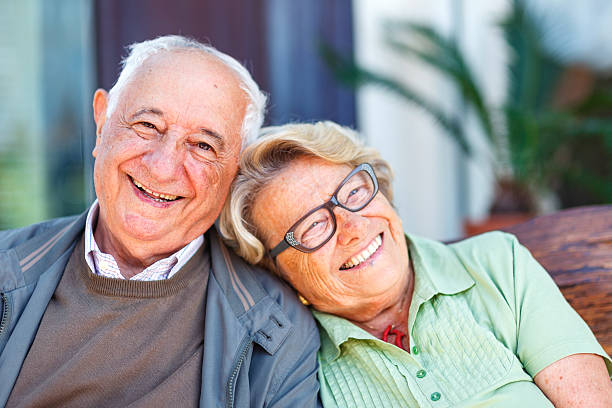 Elderly couple laughing stock photo