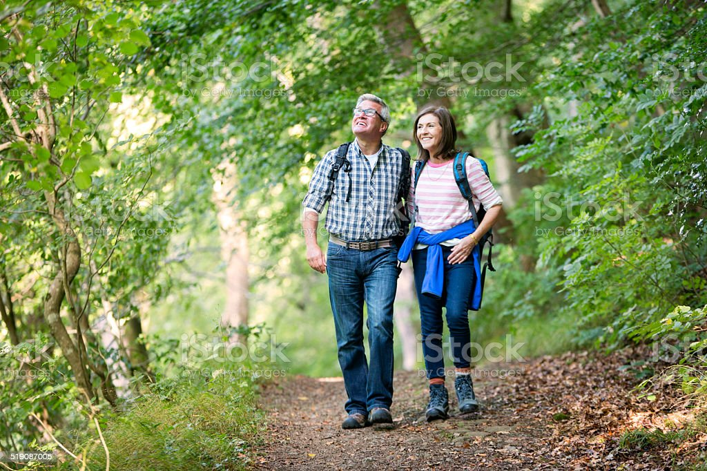 Elderly couple out for a walk stock photo
