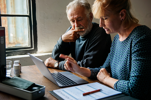Elderly Couple Planning On Life Insurance Plan Stock Photo - Download Image Now