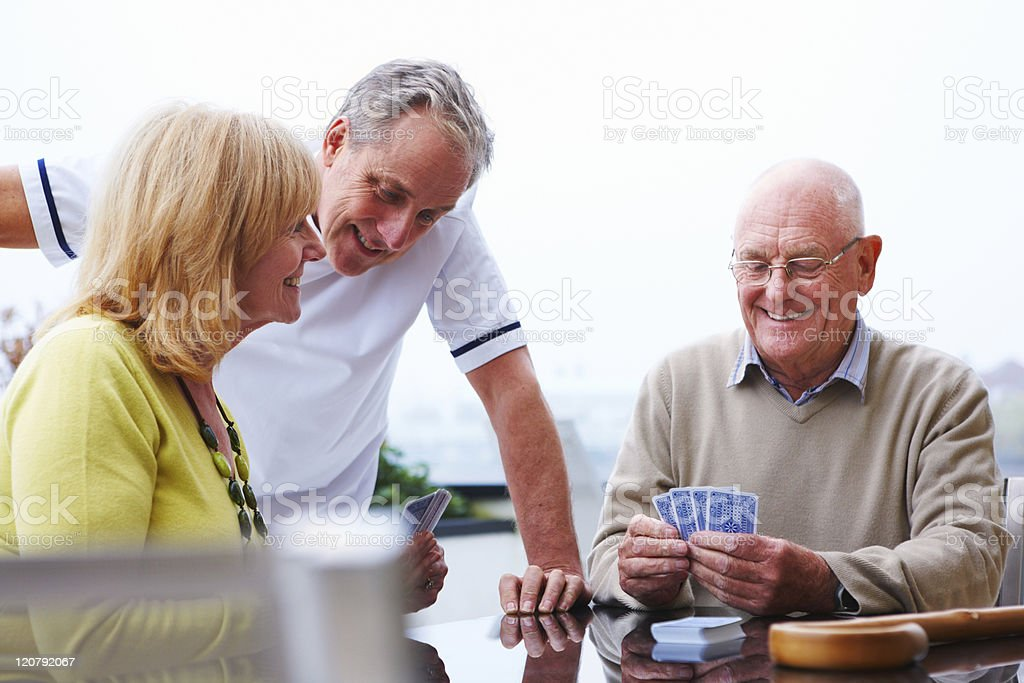 Elderly Couple Playing Cards royalty-free stock photo