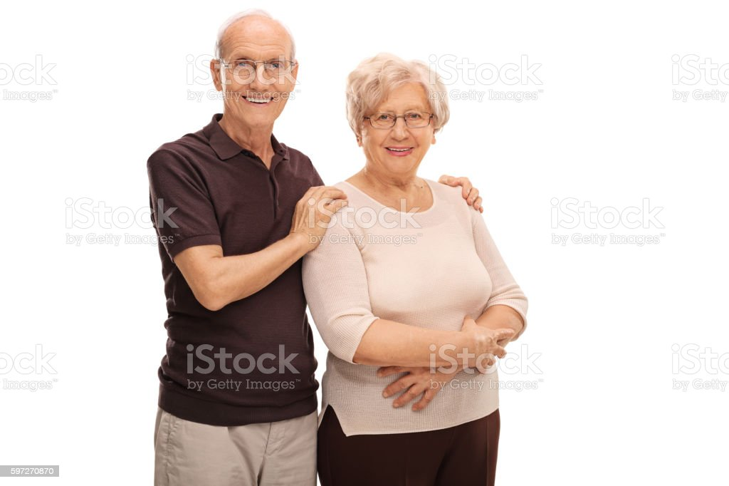 Elderly couple posing together royalty-free stock photo