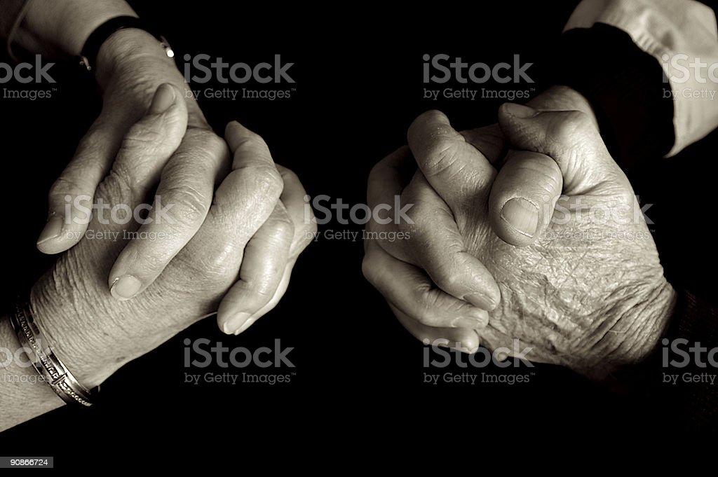 Elderly couple praying. stock photo