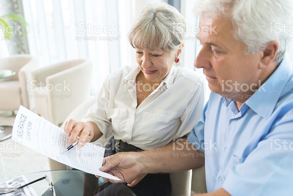 Elderly couple purchasing life insurance royalty-free stock photo