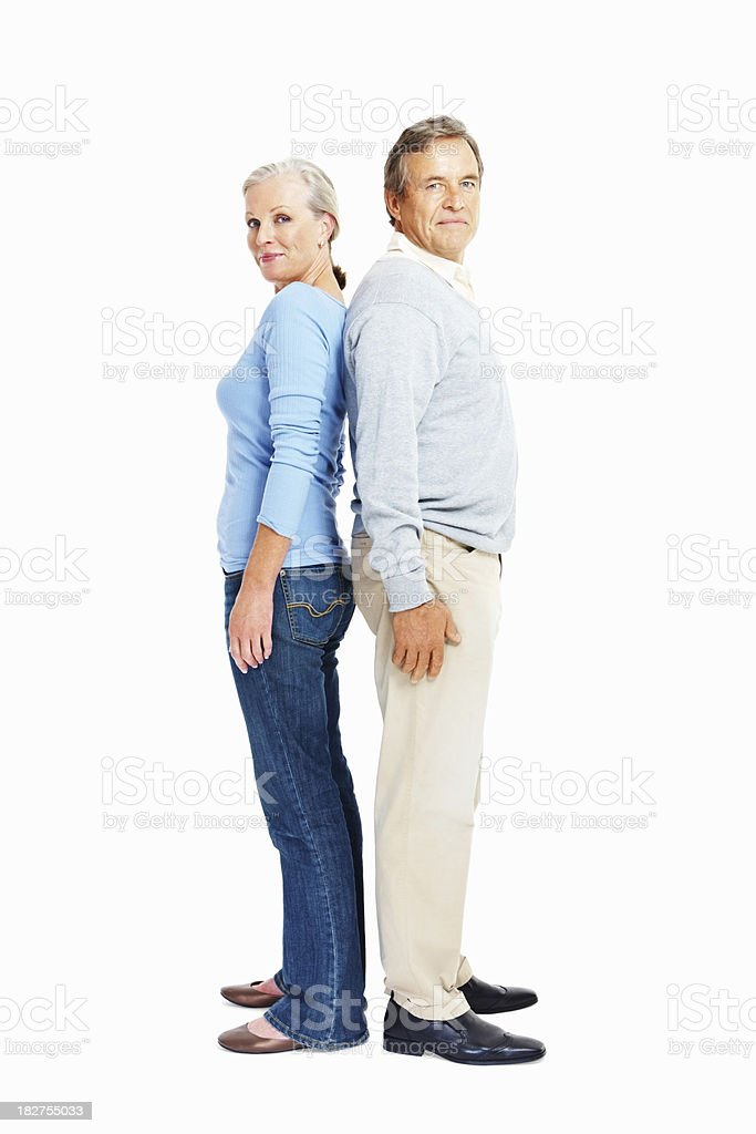 Elderly couple standing with backs together on white stock photo