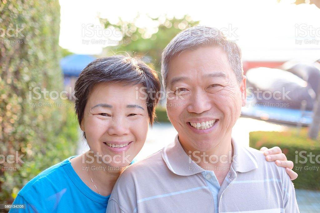 elderly couple take phone selfie stock photo