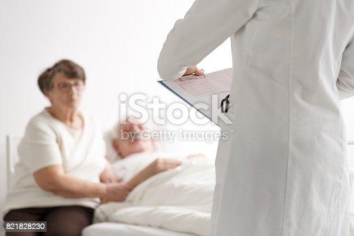 909569706 istock photo Elderly couple talking with doctor 821828230