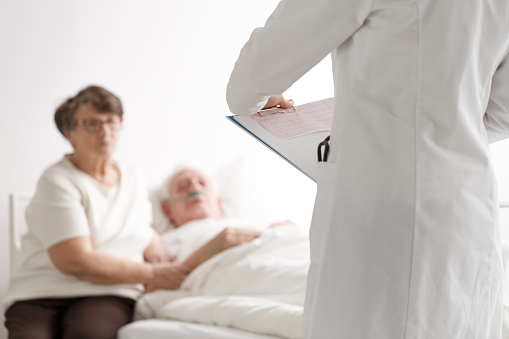 902077950 istock photo Elderly couple talking with doctor 821828230