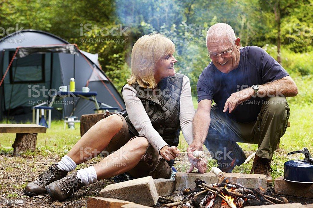 Elderly Couple Toasting Marshmallows royalty-free stock photo