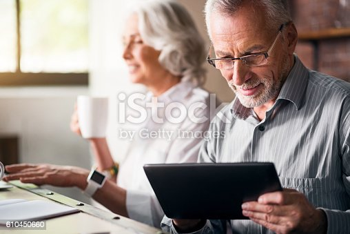 istock Elderly couple together at the kitchen 610450660
