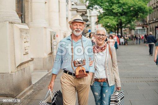 Senior couple walking while returning from shopping
