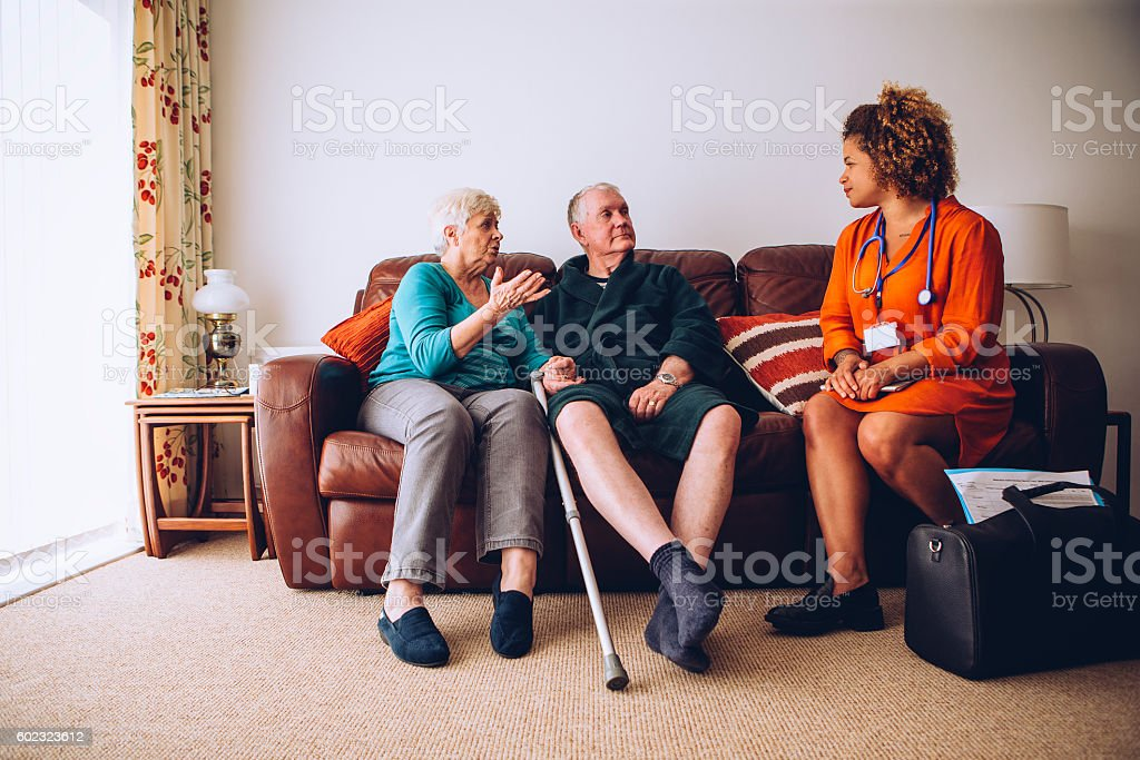 Elderly Couple with Home Carer - foto de stock