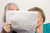 Elderly couple with newspaper